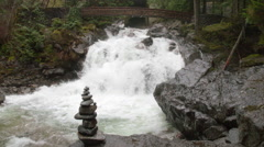 Jib Crane Shot of Waterfall at Deception Falls, Washington on Rainy Day Stock Footage