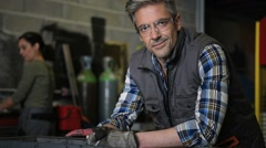 Portrait of middle-aged metalworker in workshop Stock Footage