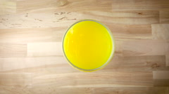Pouring Orange Juice into a Glass Aerial Shot Stock Footage