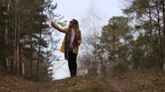 girl doing selfie outdoors in early spring - stock footage
