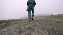 Man walks into the mist in the Peak District in Derbyshire, UK Stock Footage