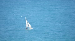 A sailboat on the horizon - stock footage