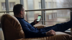 Good looking young man on his phone in chic location. Stock Footage