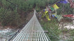 POV on suspension bridge in Nepal Stock Footage