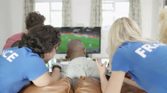 4K Friends hanging out together & watching soccer game on TV - stock footage
