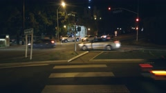 Night traffic on intersection of La Cienega and Fountain in West Hollywood, CA - stock footage