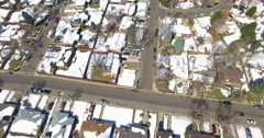 Aerial view of residential neighborhood with mountains in background. Stock Footage