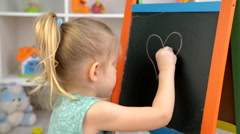 Little girl painting with chalk Stock Footage