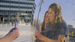 Girls Take Selfie In Front Of Giant Mirror Sculpture, They Make Silly Faces Stock Footage
