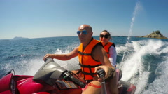 Happy young caucasian couple riding jet ski on sea Stock Footage