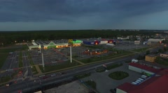 Shopping center on the outskirts of the city, evening// AERIAL FOOTAGE// Stock Footage