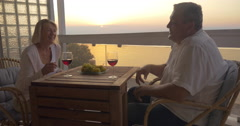 Mature couple spending time on drinking wine Stock Footage