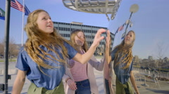 Teens Walk Around Mirror Sculpture, They Tap On It, Make Funny Faces At It - stock footage
