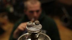 Man smokes hookah Stock Footage