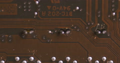 Pan across rows of circuits attached to a motherboard Stock Footage