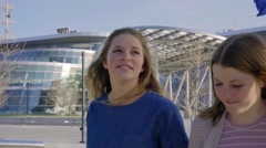 Teen Girls Talk And Walk Around City Stock Footage