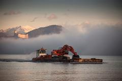 Digger on boat, Lake Maggiore, Piedmont, Lombardy, Italy Stock Photos