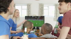 4K Group of friends watching sports game on TV celebrate when team score Stock Footage