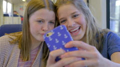 Closeup Of Two Teens Taking A Selfie On A Moving Train Stock Footage