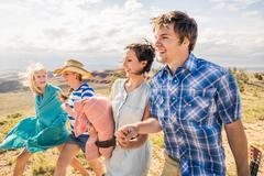 Young man and female friends walking in hills, Bridger, Montana, USA Kuvituskuvat
