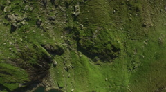 Aerial Breathtaking view of mountains, lake and green field. Stock Footage