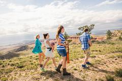 Stock Photo of Teenage girl and young adult friends walking in hills, Bridger, Montana, USA