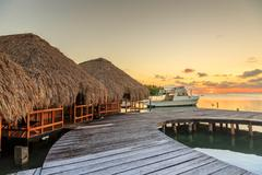Waterfront chalets and moored motor boat, St. Georges Caye, Belize, Central A Kuvituskuvat