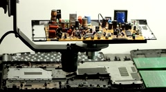 Radio components on rotation electronic board at electronics factory - stock footage