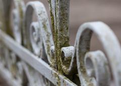 Vintage old wrought-iron fence macro photo Stock Photos