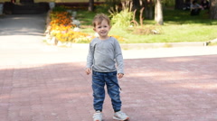Little boy pointing at something outdoor Stock Footage