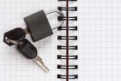 Stock Photo of Notebook with padlock and keys
