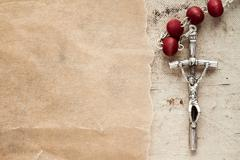 Stock Photo of Catholic rosary and paper piece