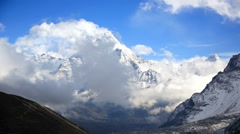 Time lapse of clouds moving around the Ama Dablam (6856m) peak near the village Stock Footage