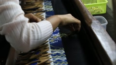 Textile manufacturer in craft village where women work on weaving loom machines Stock Footage