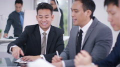 4K Corporate business group in meeting, businessman turns to smile at camera - stock footage