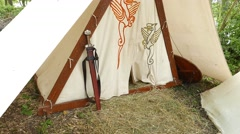 Viking sword stand at tent entrance, Norseman settlement reconstruction site Stock Footage