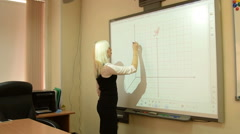 Student or teacher using interactive whiteboard Stock Footage