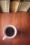 Cup of coffee with stack of old books Stock Photos