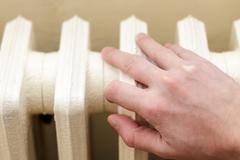 Hand on radiator Stock Photos