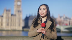 4K News reporter doing live piece to camera outdoors in the city of London - stock footage