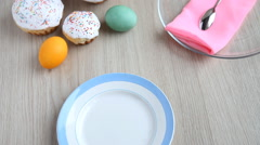 On the festive table alongside with painted eggs appears dish and Easter cake. Stock Footage