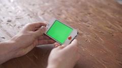 Using smart phone on wood table various hand gestures, vertical Stock Footage