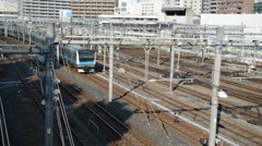 Passenger Trains moving in Ueno Station with rail cars and train tracks Stock Footage