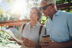 Senior tourist exploring new places to visit - stock photo