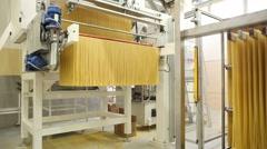 Spaghetti machinery in an italian pasta factory - stock footage