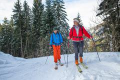 Alpine skiing with alpine guide instructor Stock Photos
