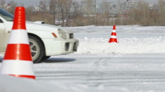 Racing car goes across finish line on a racing in winter Stock Footage
