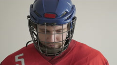 Closeup Portrait of a Hockey Player in Helmet against White Backround - stock footage