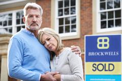 Mature Couple Forced To Sell Home Through Financial Problems - stock photo