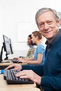 Mature Man Attending Computer Class Stock Photos